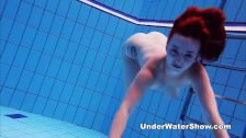 Underwater Show – redheaded cutie swimming nude in the pool
